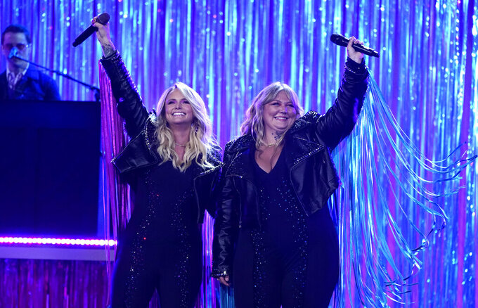 Miranda Lambert, left, and Elle King perform at the 56th annual Academy of Country Music Awards on Saturday, April 17, 2021, at the Grand Ole Opry in Nashville, Tenn. The awards show airs on April 18 with both live and prerecorded segments. (AP Photo/Mark Humphrey)