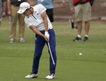 Takumi Kanaya of Japan plays his second shot on the first hole during the second round of the Australian Open golf tournament in Sydney, Friday, Dec. 6, 2019. (AP Photo/Rick Rycroft)