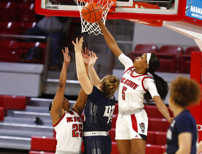 NC State's Jada Boyd (5) blocks the shot by North Florida's Emma Broermann (40) during the second half of an NCAA college basketball game at Reynolds Coliseum in Raleigh, N.C., Wednesday, Nov. 25, 2020. (Ethan Hyman/The News & Observer via AP)