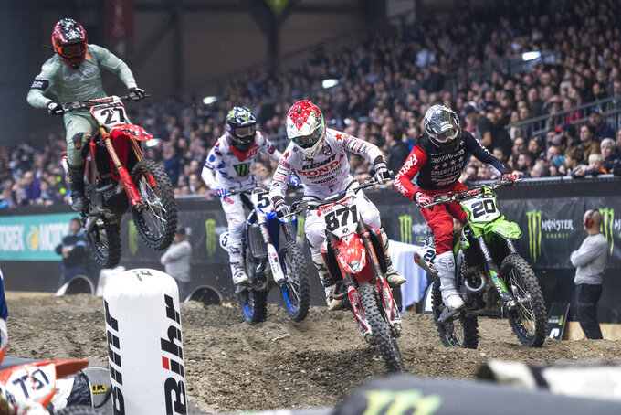 FILE - In this Nov. 30, 2018, file photo, competitors start the 33th Geneva International Supercross races at the Palexpo in Geneva, Switzerland. Supercross joined the rest of the sports world in shutting down during the coronavirus pandemic. Following the lead of NASCAR and UFC, the roughest sport on wheels returns this weekend. (Adrien Perritaz/Keystone via AP, File)