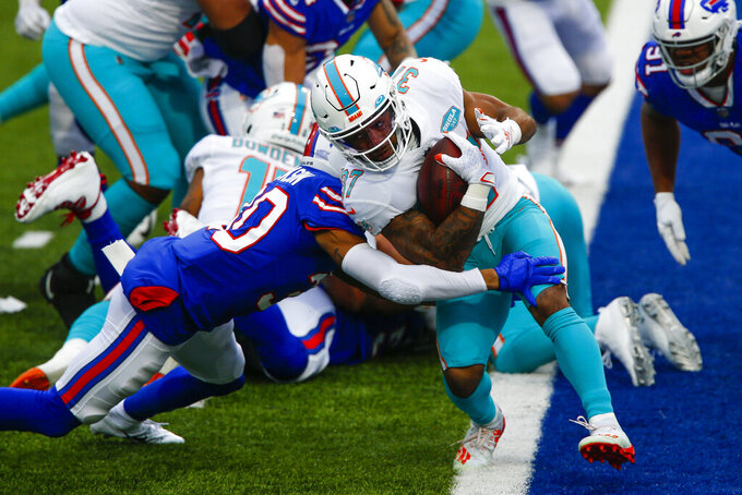 Miami Dolphins running back Myles Gaskin (37) is tackled by Buffalo Bills cornerback Dane Jackson (30) in the first half of an NFL football game, Sunday, Jan. 3, 2021, in Orchard Park, N.Y. (AP Photo/John Munson)