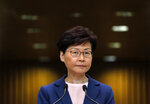 Hong Kong Chief Executive Carrie Lam pauses during a press conference in Hong Kong, Tuesday, July 9, 2019. Lam said Tuesday the effort to amend an extradition bill was dead, but it wasn't clear if the legislation was being withdrawn as protesters have demanded. (AP Photo/Vincent Yu)