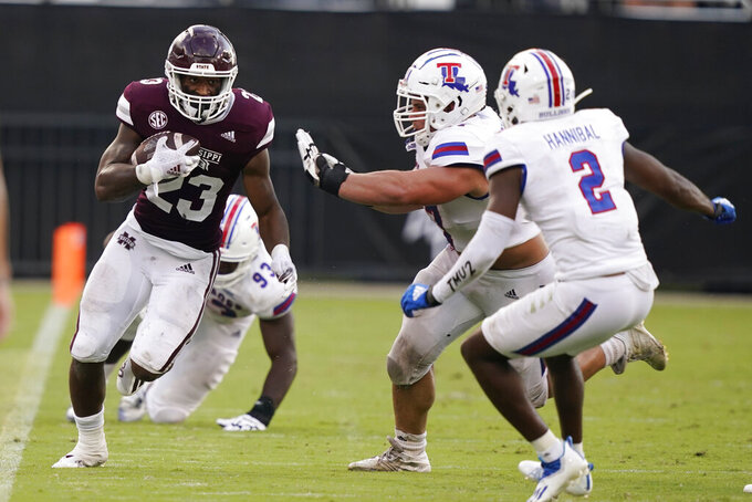 Mississippi State running back Dillon Johnson (23) runs along the sideline as Louisiana Tech defenders pursue him during the second half of an NCAA college football game in Starkville, Miss., Saturday, Sept. 4, 2021. Mississippi State won 35-34. (AP Photo/Rogelio V. Solis)