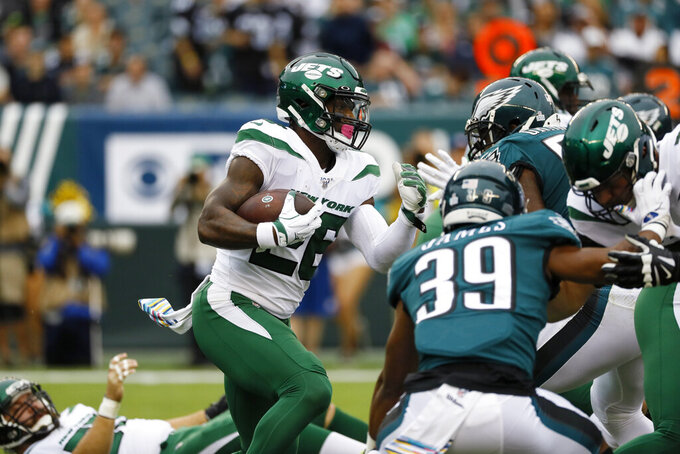 New York Jets' Le'Veon Bell rushes during the first half of an NFL football game against the Philadelphia Eagles, Sunday, Oct. 6, 2019, in Philadelphia. (AP Photo/Michael Perez)