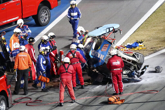 Rescue workers arrive to check on Ryan Newman after he was involved in a wreck on the last lap of the NASCAR Daytona 500 auto race at Daytona International Speedway, Monday, Feb. 17, 2020, in Daytona Beach, Fla. Sunday's race was postponed because of rain. (AP Photo/David Graham)