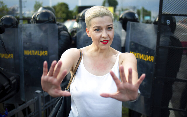 FILE - In this Aug. 30, 2020, file photo, Maria Kolesnikova, one of Belarus' opposition leaders, gestures during a rally in Minsk, Belarus. Kolesnikova, a professional flute player with no political experience, emerged as a key opposition activist in Belarus. She has appeared at protests of authoritarian President Alexander Lukashenko after he was kept in power by an Aug. 9 election that his critics say was rigged. (Tut.By via AP, File)