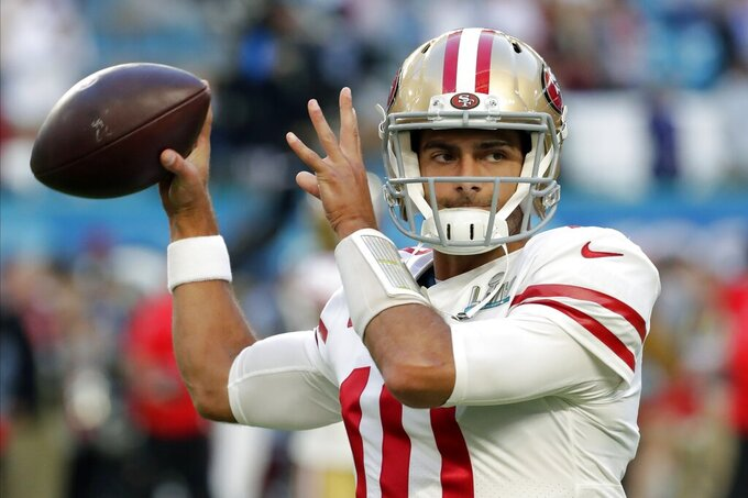 San Francisco 49ers quarterback Jimmy Garoppolo warms up before the NFL Super Bowl 54 football game against Kansas City Chiefs Sunday, Feb. 2, 2020, in Miami Gardens, Fla. (AP Photo/Matt York)