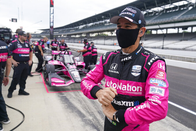 Helio Castroneves, of Brazil, waits in the pits before a practice session for a IndyCar auto race at Indianapolis Motor Speedway, Friday, Aug. 13, 2021, in Indianapolis. (AP Photo/Darron Cummings)