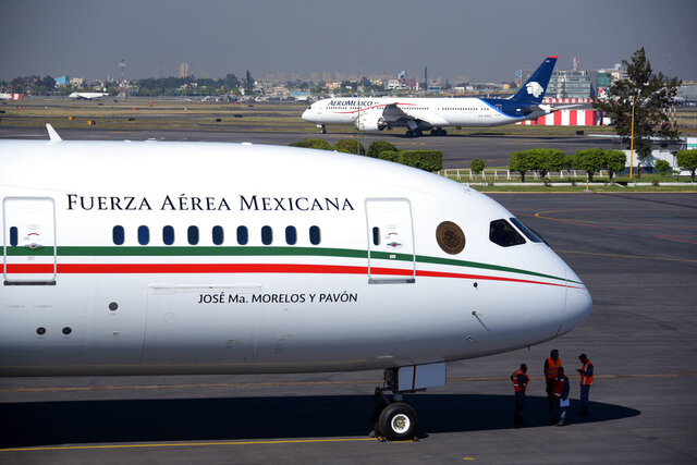 FILW - This Dec. 3, 2018 file photo provided by the Mexican Presidential press office shows the presidential airplane at the presidential hangar at Benito Juarez International Airport in Mexico City. Mexico is trying to sell its luxurious presidential jet to Canada, but will raffle the plane off if the Canadians don't want it, President Andres Manuel Lopez Obrador said Tuesday, Jan. 28, 2020. (Mexican Presidential press office via AP, File)