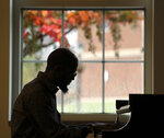 Terrance Shepherd plays piano in Covington Hall at Radford University in Radford Va., Wednesday, Nov. 11, 2020. (Matt Gentry/The Roanoke Times via AP)