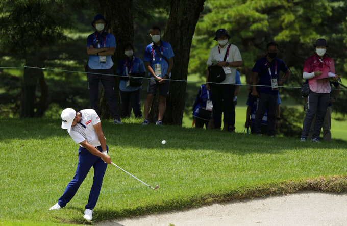 Xander Shauffele of United States plays a shot from the third fairway during the third round of the men's golf event at the 2020 Summer Olympics on Saturday, July 31, 2021, in Kawagoe, Japan. (AP Photo/Andy Wong)