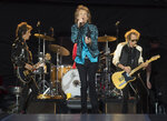 FILE - Mick Jagger, center, Keith Richards, right, and Ronnie Wood, left, of the Rolling Stones perform during the