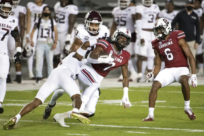 South Carolina kick returner Jammie Robinson (7) is tackled by Texas A&M defensive back Myles Jones (0) during the first half of an NCAA college football game Saturday, Nov. 7, 2020, in Columbia, S.C. (AP Photo/Sean Rayford)