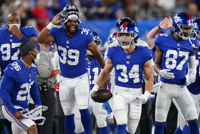 New York Giants running back Sandro Platzgummer (34) reacts after a running play in the second half of an NFL preseason football game against the New York Jets, Saturday, Aug. 14, 2021, in East Rutherford, N.J. (AP Photo/Corey Sipkin)
