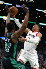 Houston Rockets' Russell Westbrook (0) shoots as Boston Celtics' Semi Ojeleye (37) defends during the first half of an NBA basketball game in Boston, Saturday, Feb. 29, 2020. (AP Photo/Michael Dwyer)