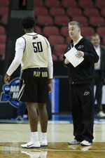 Purdue head coach Matt Painter talks with Trevion Williams during practice for the NCAA men's college basketball tournament, Wednesday, March 27, 2019, in Louisville, Ky. (AP Photo/Michael Conroy)