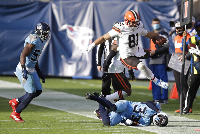 Cleveland Browns tight end Austin Hooper (81) leaps over Tennessee Titans cornerback Desmond King (33) in the second half of an NFL football game Sunday, Dec. 6, 2020, in Nashville, Tenn. (AP Photo/Ben Margot)