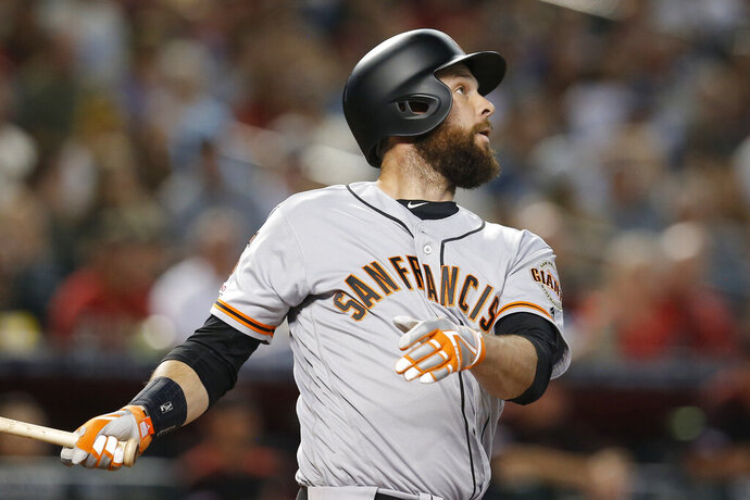 San Francisco Giants' Brandon Belt hits a grand slam against the Arizona Diamondbacks in the second inning during a baseball game, Saturday, Aug. 17, 2019, in Phoenix. (AP Photo/Rick Scuteri)