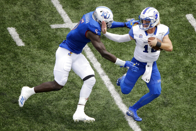 Indiana State quarterback Ryan Boyle (10) is sacked by Kansas linebacker Azur Kamara (5) during the second half of an NCAA college football game Saturday, Aug. 31, 2019, in Lawrence, Kan. Kansas won 24-17. AP Photo/Charlie Riedel)