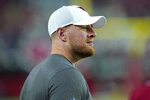 Arizona Cardinals defensive end J.J. Watt watches from the sidelines during the first half of an NFL preseason football game against the Dallas Cowboys, Friday, Aug. 13, 2021, in Glendale, Ariz. (AP Photo/Ross D. Franklin)