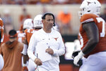 Texas head coach Steve Sarkisian greets players as they run off the field after a score against Louisiana-Lafayette during the second half of an NCAA college football game Saturday, Sept. 4, 2021, in Austin, Texas. (AP Photo/Eric Gay)