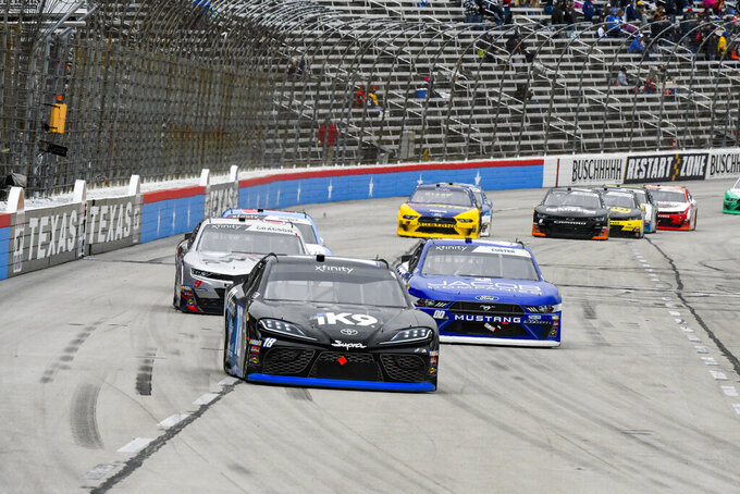 Driver Kyle Busch races down the front stretch during a NASCAR auto race at Texas Motor Speedway, Saturday, March 30, 2019, in Fort Worth, Texas. (AP Photo/Larry Papke)