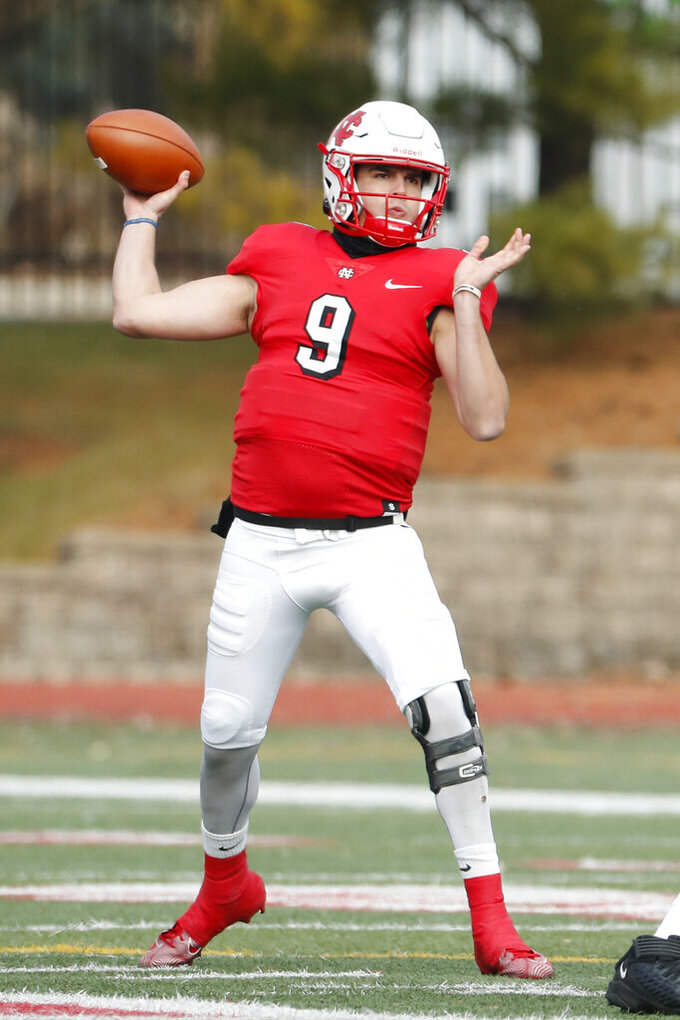 In this Nov. 23, 2019 photo, provided by North Central College Athletics, North Central quarterback Broc Rutter throws a pass against Wabash during an NCAA college football game in Naperville, Ill. Rutter was selected to the Division III All-America first team on Thursday, Dec. 19, 2019.  (Steve Woltmann/North Central College Athletics via AP)