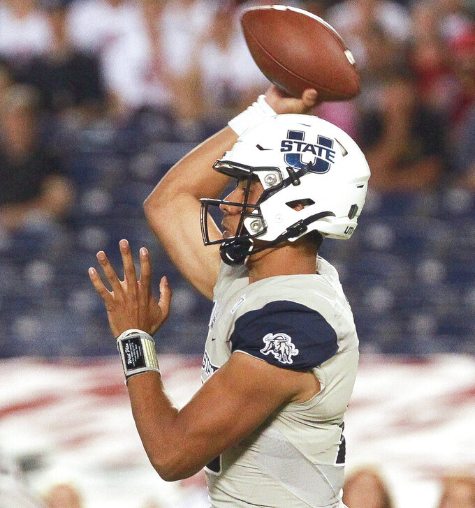 Utah State quarterback Jordan Love throws a pass against San Diego State during an NCAA college football game Saturday, Sept. 21, 2019, in San Diego. (Hayne Palmour IV/The San Diego Union-Tribune via AP)