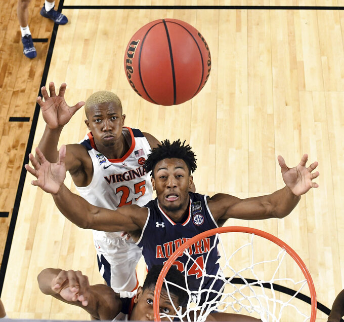 Auburn's Anfernee McLemore (24) and Virginia's Mamadi Diakite (25) reach for a rebound during the second half in the semifinals of the Final Four NCAA college basketball tournament between Auburn and Virginia, Saturday, April 6, 2019, in Minneapolis. (Jamie Schwaberow/NCAA Photos via Getty Images via AP, Pool)