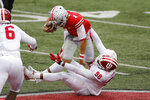 Indiana defensive lineman Jerome Johnson, bottom, sacks Ohio State quarterback Justin Fields during the first half of an NCAA college football game Saturday, Nov. 21, 2020, in Columbus, Ohio. (AP Photo/Jay LaPrete)