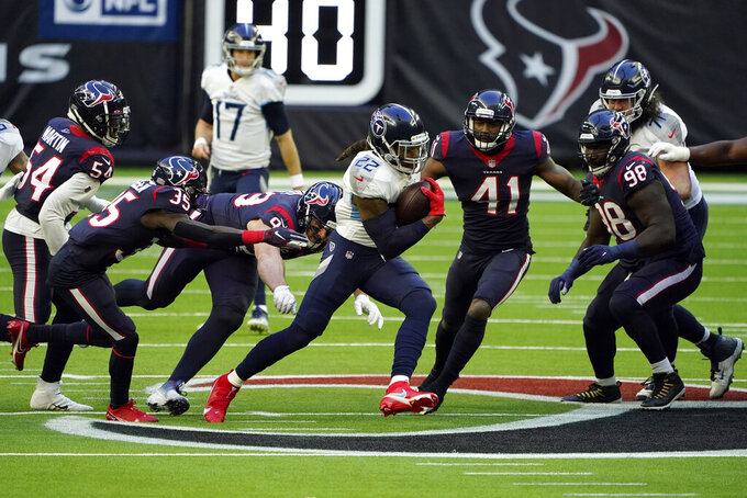 Tennessee Titans running back Derrick Henry (22) breaks away from Houston Texans defenders for a 52-yard touchdown run during the first half of an NFL football game Sunday, Jan. 3, 2021, in Houston. (AP Photo/Eric Christian Smith)