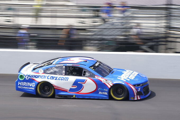 Kyle Larson drives down the main straightaway during a NASCAR Series auto race at Indianapolis Motor Speedway, Sunday, Aug. 15, 2021, in Indianapolis. (AP Photo/Darron Cummings)