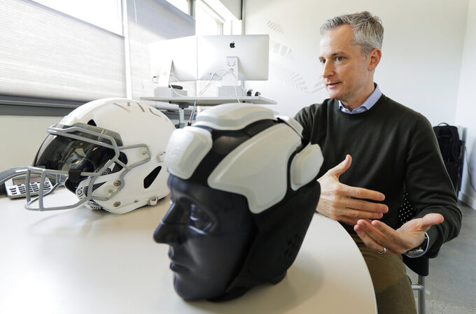 In this photo taken May 23, 2019, Dave Marver, CEO of VICIS, a Seattle-based company that makes football helmets, talks in Seattle about his company's latest offering, the ULTIM cap. VICIS announced on Monday, July 1, the cap is intended for use with youth flag football and the quickly expanding competitive 7-on-7 football played during the offseason for youth and high school programs. (AP Photo/Ted S. Warren). (AP Photo/Ted S. Warren)