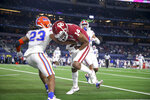 Oklahoma wide receiver Charleston Rambo (14) catches a touchdown pass next to Florida defensive back Jaydon Hill (23) during the Cotton Bowl NCAA college football game in Arlington, Texas, Wednesday, Dec. 30, 2020. (Ian Maule/Tulsa World via AP)