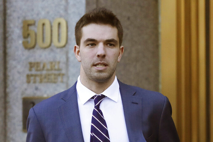FILE - In this March 6, 2018 file photo, Billy McFarland, the promoter of the failed Fyre Festival in the Bahamas, leaves federal court after pleading guilty to wire fraud charges in New York. More than three years after the highly publicized Fyre Festival famously fizzled out in the Bahamas, merchandise and other