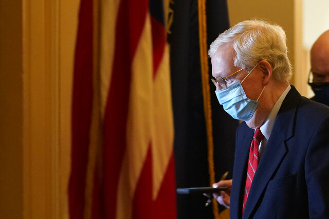 Senate Majority Leader Mitch McConnell of Ky., walks back to his office on Capitol Hill in Washington, Monday, Nov. 9, 2020. (AP Photo/Susan Walsh)