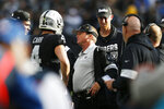 Oakland Raiders head coach Jon Gruden, center, talks with quarterback Derek Carr (4) during the second half of an NFL football game against the Jacksonville Jaguars in Oakland, Calif., Sunday, Dec. 15, 2019. (AP Photo/D. Ross Cameron)