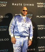 """Haute Living hosted party for Fat Joe's new album """"Family Ties"""" Saturday night Dec. 7, 2019 during the week of Art Basel Miami. Wearing a baby blue track suit, the rapper entertained guests including DJ Khaled, Fabolous, Jeezy, and Too $hort. (AP Photo/Kelli Kennedy)"""