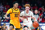 Arizona guard Nico Mannion (1) drives on Arizona State guard Jaelen House in the second half during an NCAA college basketball game, Saturday, Jan. 4, 2020, in Tucson, Ariz. Arizona won 75-47. (AP Photo/Rick Scuteri)