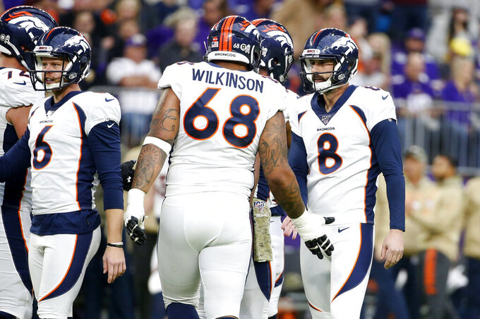 Denver Broncos kicker Brandon McManus (8) celebrates with teammates after making a 47-yard field goal during the first half of an NFL football game against the Minnesota Vikings, Sunday, Nov. 17, 2019, in Minneapolis. (AP Photo/Bruce Kluckhohn)