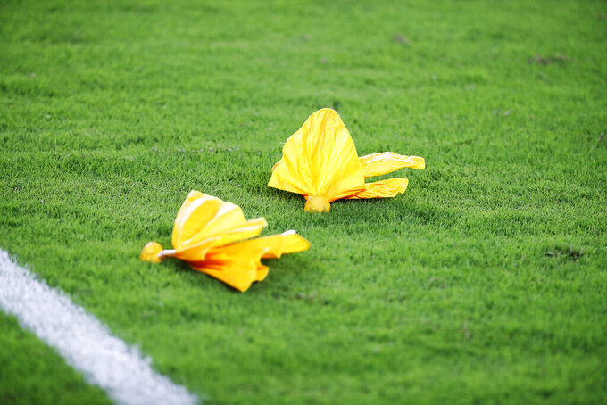 FILE - In this Thursday, Aug. 22, 2019, file photo, penalty flags lie on the field after a play during the first half of an NFL football preseason game between the Miami Dolphins and the Jacksonville Jaguars, in Miami Gardens, Fla. The guys in stripes are getting plenty of NFL face time, and there's plenty of blame to go around as the league deals with a troubling barrage of penalties. (AP Photo/Wilfredo Lee, File)