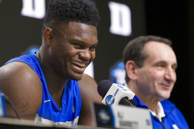 Duke forward Zion Williamson smiles as he speaks, accompanied by head coach Mike Krzyzewski, during an NCAA men's college basketball news conference in Washington, Saturday, March 30, 2019. Duke plays Michigan State in the East Regional final game on Sunday.(AP Photo/Alex Brandon)