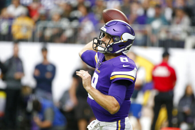 Minnesota Vikings quarterback Kirk Cousins throws a pass during the second half of an NFL football game against the Philadelphia Eagles, Sunday, Oct. 13, 2019, in Minneapolis. (AP Photo/Bruce Kluckhohn)