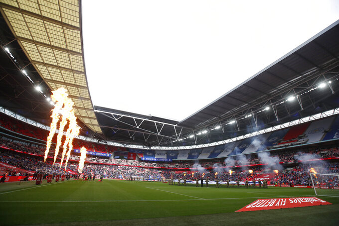 The teams enter the field for the FA Cup final soccer match between Chelsea and Leicester City at Wembley Stadium in London, England, Saturday, May 15, 2021. (Matt Childs/Pool via AP)