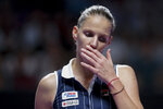 Karolina Pliskova of the Czech Republic reacts as she plays against Ashleigh Barty of Australia during the WTA Finals Tennis Tournament at the Shenzhen Bay Sports Center in Shenzhen, China's Guangdong province, Saturday, Nov. 2, 2019. (AP Photo/Andy Wong)