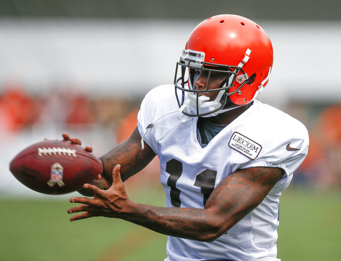 FILE - In this Aug. 12, 2018, file photo, Cleveland Browns wide receiver Antonio Callaway catches a pass during NFL football training camp in Berea, Ohio. Browns coach Freddie Kitchens said benching Callaway is a one-game punishment. Callaway did not play in Sunday's 19-16 win over the Buffalo Bills. He was a surprising addition to the inactives list after being included in the game plan. Kitchens has not divulged his reason for sitting Callaway, who was suspended four games earlier this season by the NFL for violating the league's drug policy. (AP Photo/Ron Schwane, File)