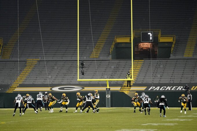 The stands in the end zones at Lambeau Field are empty during the first half of an NFL football game between the Green Bay Packers and the Carolina Panthers Saturday, Dec. 19, 2020, in Green Bay, Wis. (AP Photo/Morry Gash)