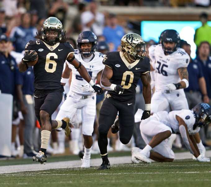 Wake Forest's Ja'Sir Taylor (6) takes a kickoff return in for a first-half touchdown against Old Dominion during an NCAA college football game Friday, Sept. 3, 2021, in Winston-Salem, N.C. (Walt Unks/The Winston-Salem Journal via AP)