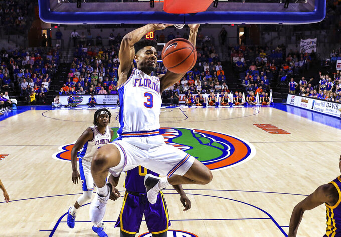 Florida guard Jalen Hudson (3) dunks during the second half of the team's NCAA college basketball game against LSU in Gainesville, Fla., Wednesday, March 6, 2019. (AP Photo/Gary McCullough)
