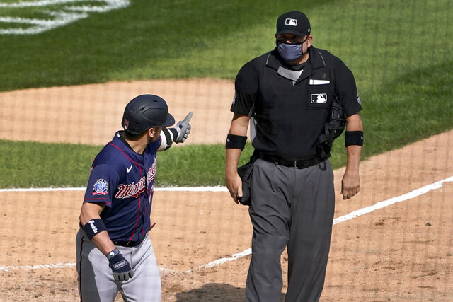 Minnesota Twins' Josh Donaldson gives home plate umpire Dan Bellino the thumbs up sign after Bellino ejected him from the baseball game during the sixth inning against the Chicago White Sox, Thursday, Sept. 17, 2020, in Chicago. (AP Photo/Charles Rex Arbogast)